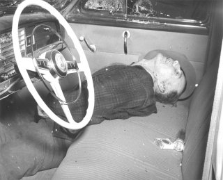 Ervin Kaser's body in his car