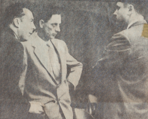 This picture of Casper Oveross talking with his attorneys Bruce Williams, left, and Otto Skopil, Jr., was taken just before the three went into Judge George Duncan's chambers to argue on the defnse motion of a directed verdict of acquital. The motion was denied by the judge and the trial of Oveross for first degree murder of Ervin Kaser continues with the defense beginning its case.
