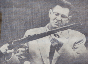 Portland Chemist E. Nealley Wood examines rust on the barrel of a Winchester rifle which he testified Monday was the result of an 11-day test in water taken from the Pudding River.  Wood's testimony was part of the defnese effort to show that a rifle taken from the river May 8 could not be linked to Casper Oveross who they claim left the area April 17.